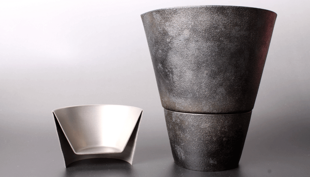A guinomi cup made by Takakuwa Industrial Products, here in a double layered design made with a single piece of titanium