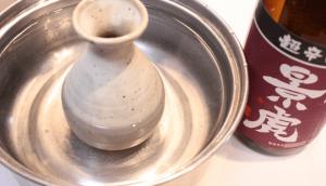 The photograph make hot sake by a pot and tokkuri