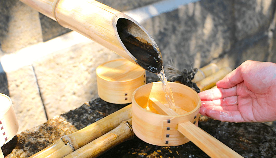 A water spout for cleansing the hands at the entrance to Gokonomiya Shrine