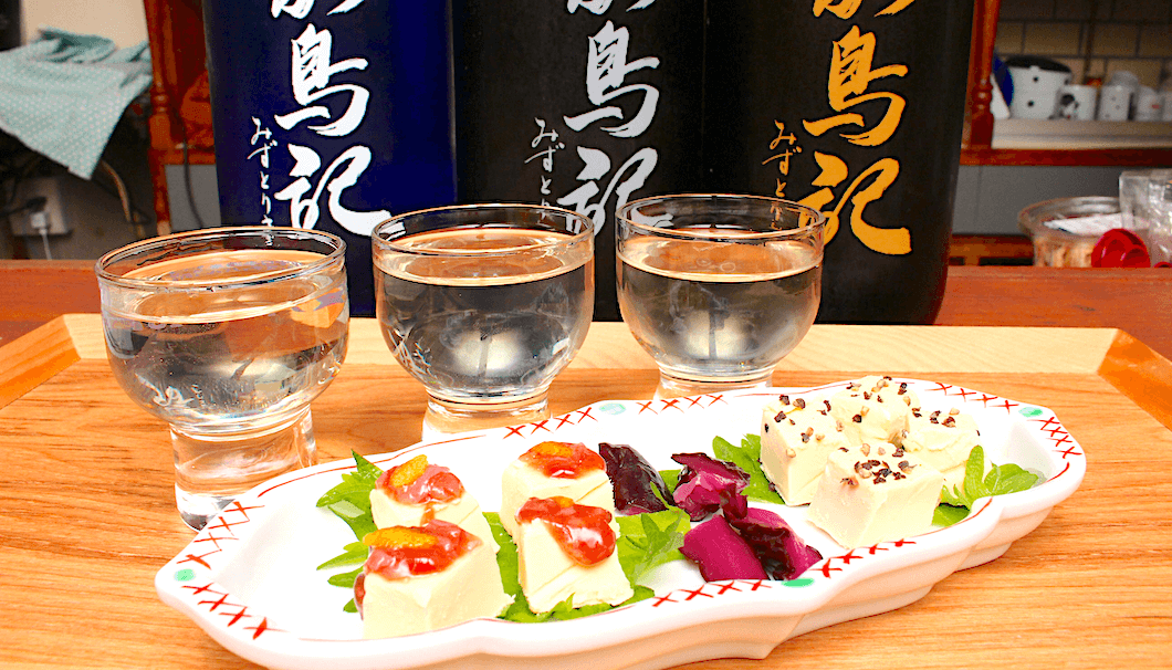 A tasting flight of Miyagi sake paired with a cream cheese plate that leaves you wanting more of both