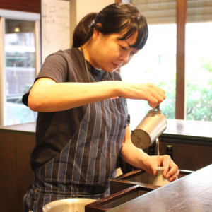 Marie Chiba is pouring sake to tokkuri for serving kanzake